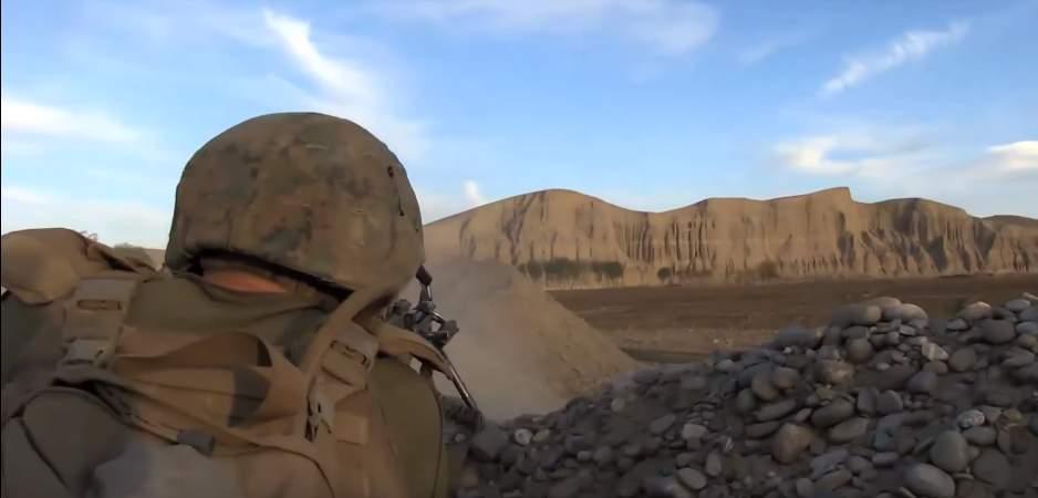 Marine fires at ridgeline - US Marines react to surprise ambush by the Taliban
