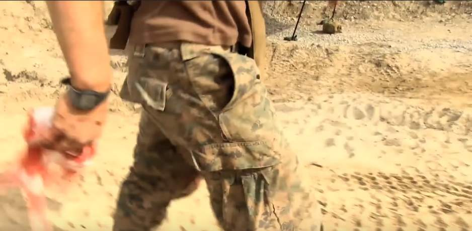 Marine holds blood soaked rag - US Marines react to surprise ambush by the Taliban