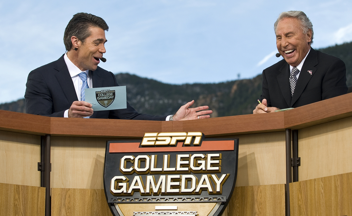 "Chris Fowler, left, and Lee Corso, right, two of ESPN's ""College GameDay"" broadcasters joke during a live broadcast from the U.S. Air Force Academy Nov. 7 before the Air Force vs. Army football game. The latest Academy visit is part of ESPN's salute to veterans of the U.S. armed forces, which will include a week of programming -- ""America's Heroes: A Salute to Our Veterans"" -- culminating in special ""SportsCenter"" editions from West Point on Veterans Day, Nov. 11. This is ""College GameDay's"" third visit to the Academy. (U.S. Air Force photo by/Staff Sgt. Bennie J. Davis III)"