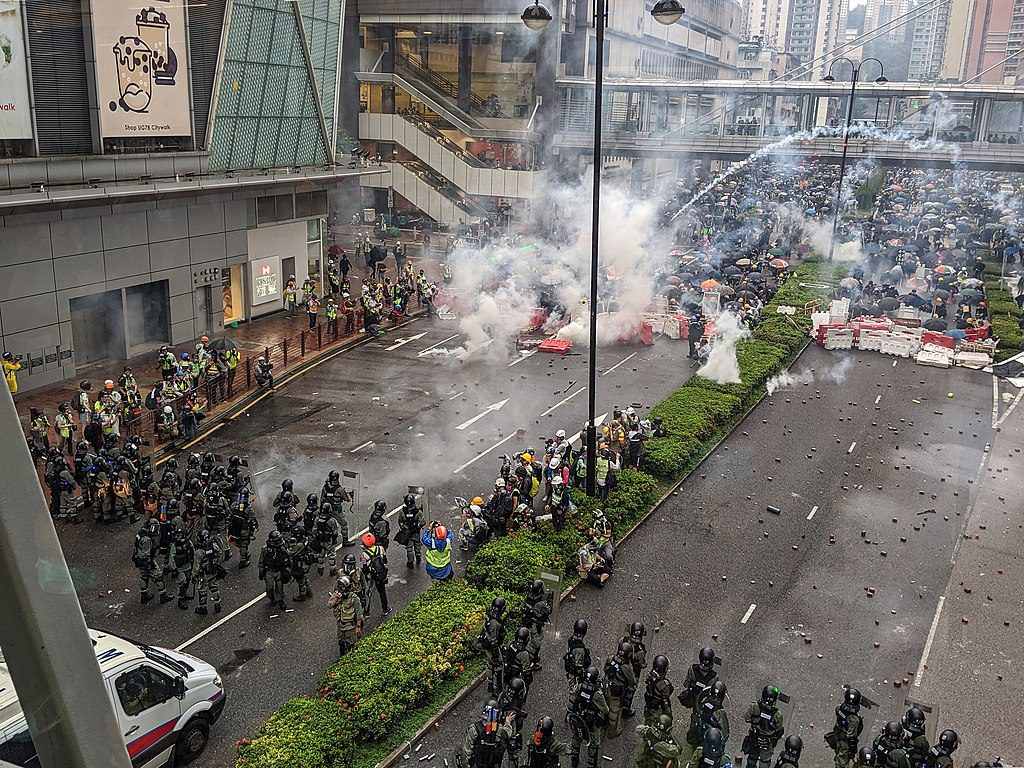 Protests, clashes continue in Hong Kong after mass masked protest march