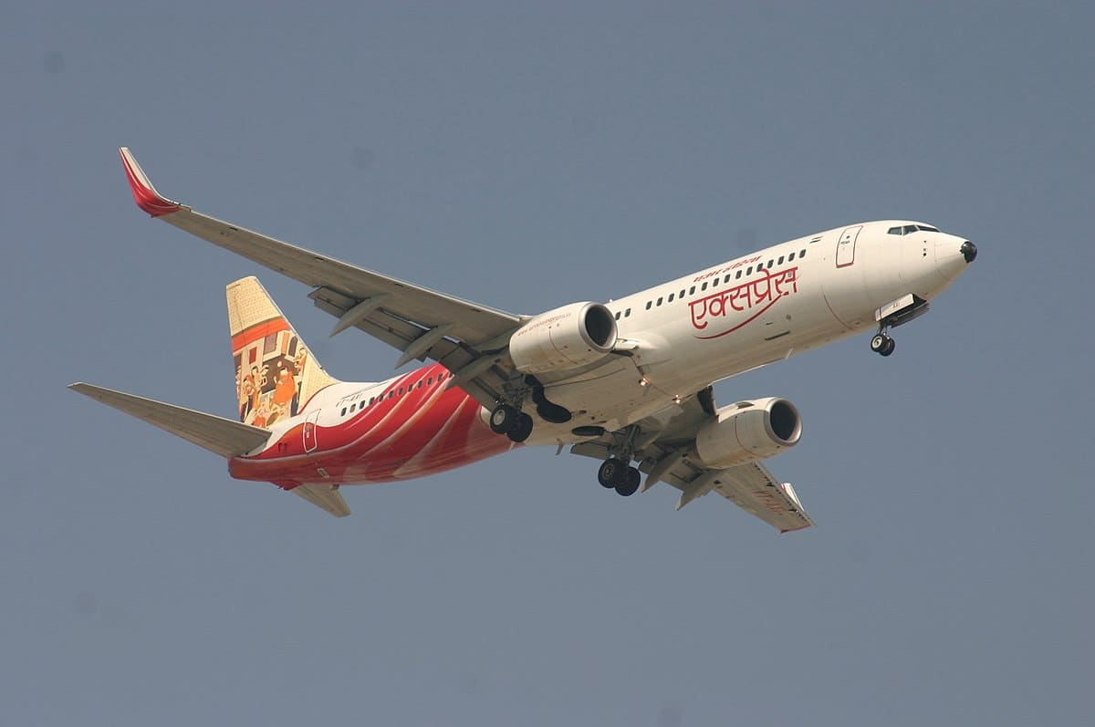 Pics/Videos: Air India flight splits in two in crash landing; deaths reported