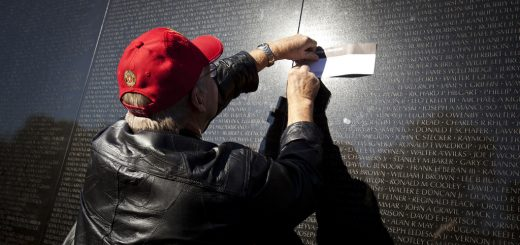 Mike Simon, who served in Vietnam from 1966 to 1967, takes a rubbing of a fellow Marine's name from the Vietnam Veteran's Memorial Wall Nov. 11, 2010. Hundreds of veterans and supporters gather in the Nation's Capital on Veteran's Day each year.