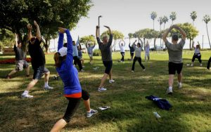 Coast Guard members participate in yoga workouts