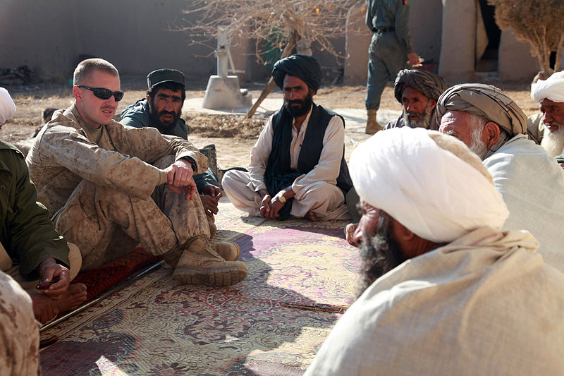 Major Jason Brezler in 2009 while he was a Corps Caption, speaking with Afghan leaders.