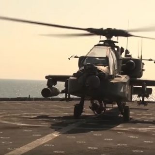U.S. Army Apache Helicopter Landing On a moving ship.