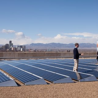 President Barack Obama wth Vice President Joe Biden speaks with CEO of  Namaste Solar Electric, Inc., Blake Jones,  while looking at solar panels  at the Denver Museum of Nature and Science in Denver, Colorado 2/17/09.  Official White House Photo by Pete Souza