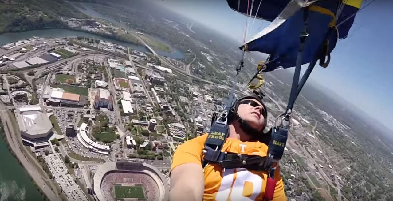 Watch This Incredible 60FPS Video Footage Of Navy SEALs Parachuting Into A Huge College Stadium Featured