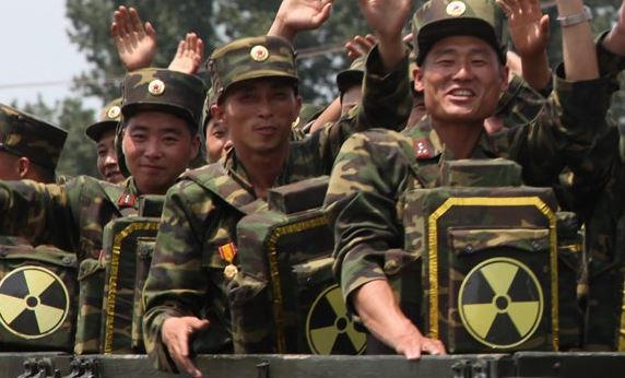 """North Korea Unveils Photos Of Soldiers Wearing """"Nuclear Backpacks"""" Featured"""
