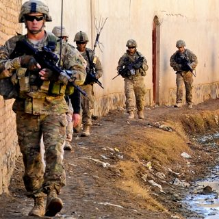 Defense.gov News Photo 120128 F SA682 088   U.S. troops walk to the Department of Public Works facility and a water distribution point to inspect a project in Kandahar province Afghanistan 320x320 - How many US troops in Afghanistan? Pentagon changes how it counts them