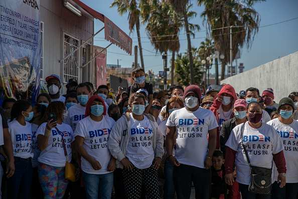 Photos: Migrant group wearing Biden shirts try to cross US/Mexican border