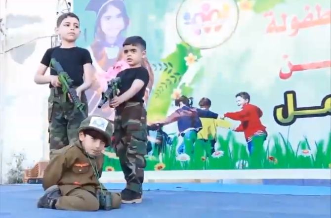 Hamas - Video shows armed Hamas children joyfully mock-executing Israeli child