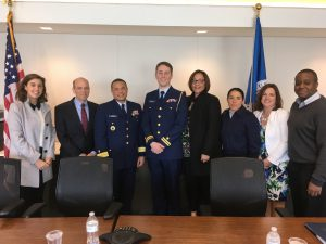"(From left to right) Brianne Alvis, Gary Rasicot, Rear Adm. Michael Johnston, Lt. Alex Rulon, Nicole Carter, SK3 Sasha Rodriguez, Kathy Scott, and Jaurin Joseph pose for a photo at a ""How Inspiring Leaders Build a Culture of Engagement"" event."