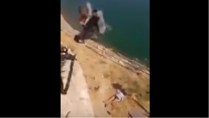 Iraqi troops throw ISIS fighters off cliff - (VIDEO) Iraqi troops throw ISIS fighters off a cliff to their deaths and then shoot them