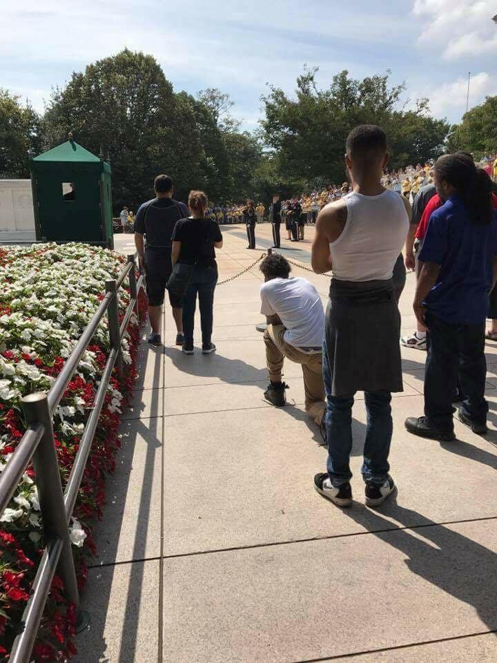 Kneeling at Tomb - Picture of man kneeling during taps at Tomb of the Unknown Soldier is sparking outrage following NFL protests
