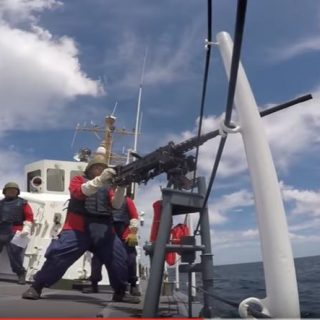 U.S. Coast Guardsman Machine Gun Live Fire Drills