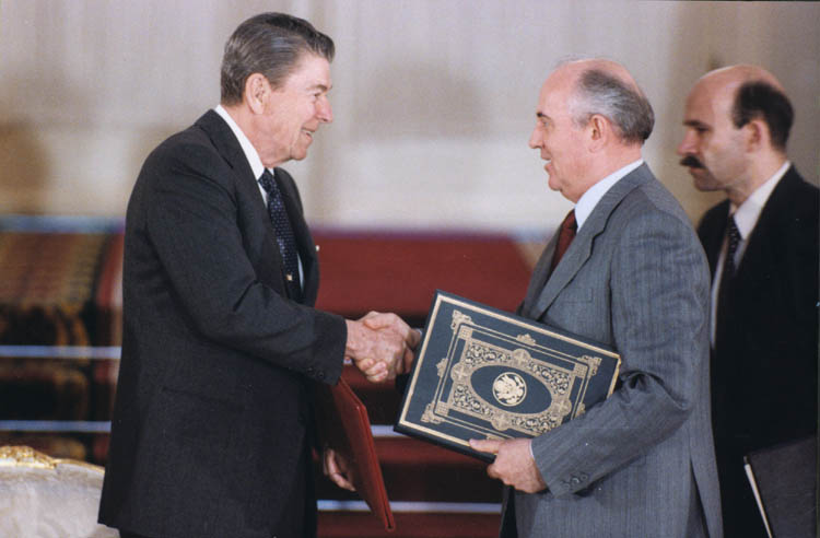 President Reagan and Soviet General Secretary Gorbachev shake hands after signing the INF Treaty in 1988.