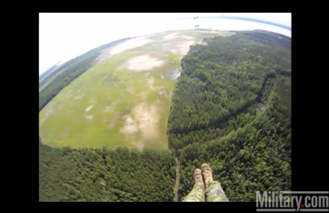 FUNNY: Paratrooper NONE Too Happy About His Landing Spot. [Warning: Strong Language] Featured