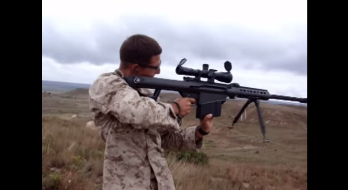 Marine Shoots .50 Cal Standing Up Featured