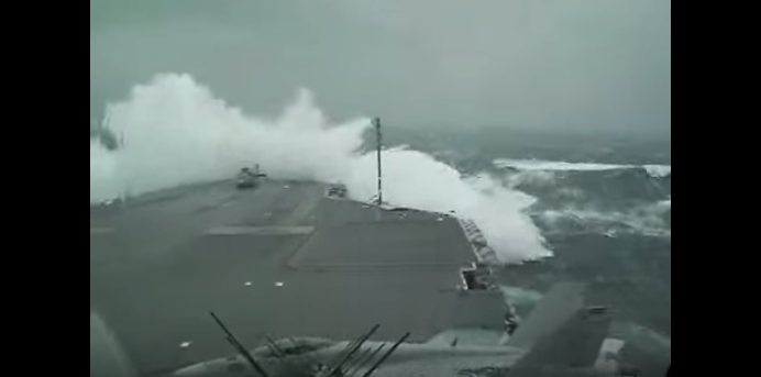 (VIDEO) Aircraft Carrier Takes On High Seas Featured