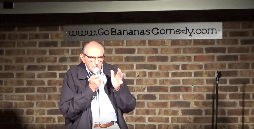 (WATCH) 89 Year Old Tries Stand Up Comedy For First Time, Leaves Crowd In Tears Of Laughter Featured