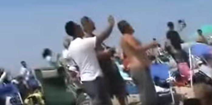 (WATCH) FA-18 Creates Sonic Boom Vapor Cone Over Stunned Beachgoers Featured