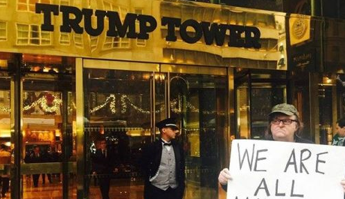 Michael Moore Stands Next To Trump Tower Holding Truly Bizarre Sign Featured
