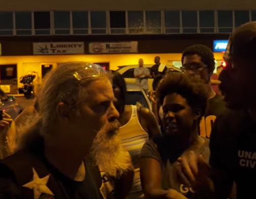 Watch Intense HD Video Of This Veteran Confronting An Angry Flag-Stomping Mob Of Protesters Featured