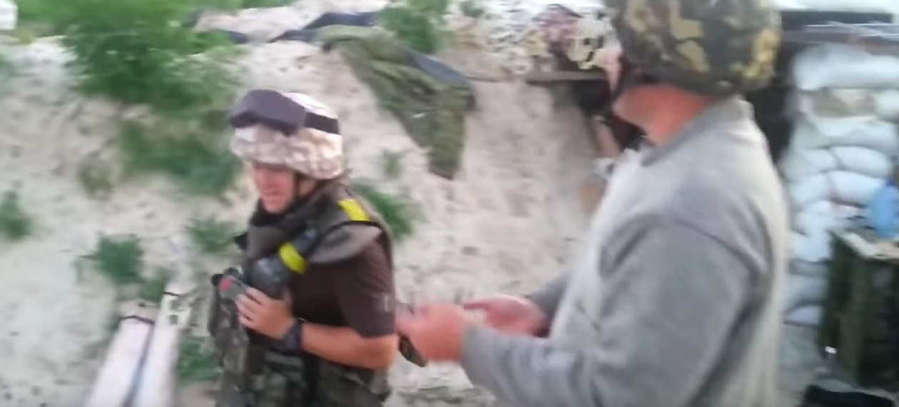 Watch Ukrainian Soldiers Playing With Shrapnel While Being Shelled Featured