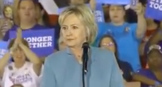 Hillary Clinton Goes Into Panic Mode, Security Steps In, While Protesters Shout At Her On Stage Featured