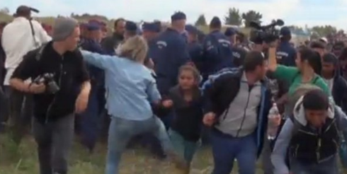 """Camerawoman Who Tripped Migrants In Hungary Gets Charged With """"Breach Of Peace"""" Featured"""