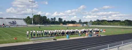 School Chooses Not To Play National Anthem During Football Game, Football Team Stands For It Anyways Featured