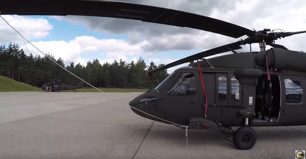 Watch The U.S. Army 1st Armored Div. Combat Aviation Brig. Conduct An Aerial Gunnery With Black Hawk Helicopters Featured