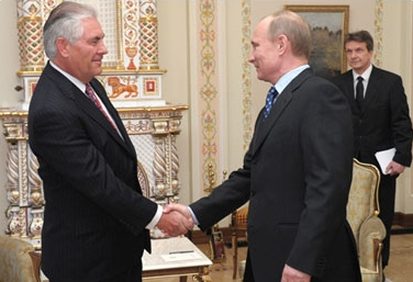Exxon CEO Rex Tillerson with Russian President Vladimir Putin.