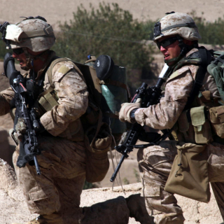 U.S. Marine Corps Lance Cpl. Jose Maldonado (left) and Cpl. Rocco Urso (right), both with India Company, 3rd Battalion, 5th Marine Regiment, Regimental Combat Team 2, provide over watch security during an operation in Sangin Valley, Afghanistan, on Oct. 7, 2010. The Marines conducted a two-day operation to clear insurgents from the Wishtan area. Photo by Cpl. David Hernandez