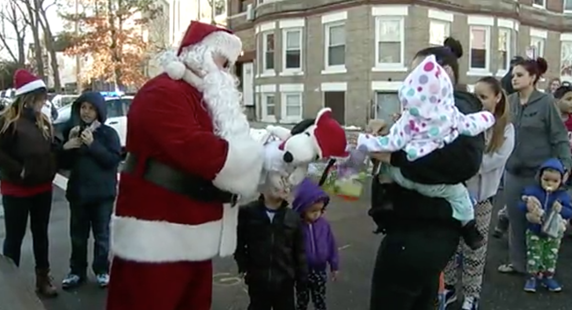 Watch A Massachusetts Police Department Deliver Christmas Gifts For Needy Children Featured