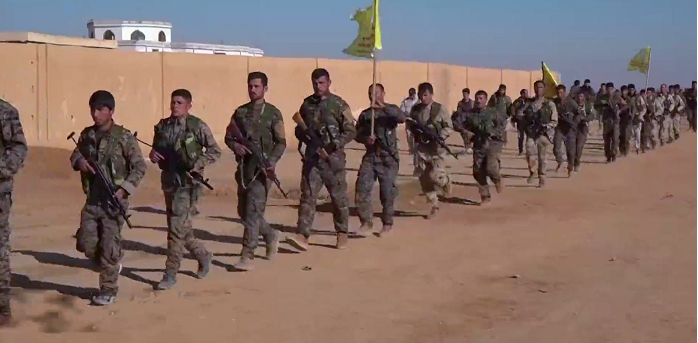 U.S. Backed Syrian Defense Forces Continue Assault On ISIS Capital In Syria Featured