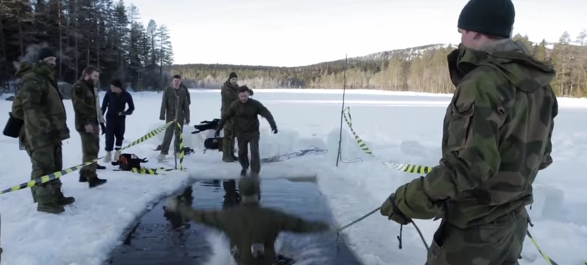 Watch U.S. Marines Freeze As They Jump Into Frigid Water In Norway Featured
