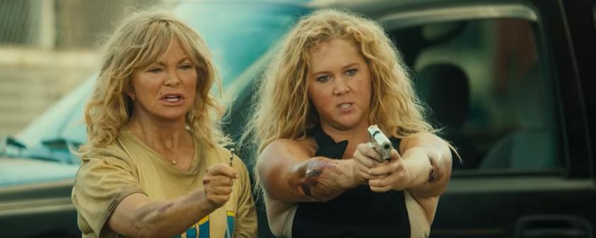 Anti-Gun Actress Amy Schumer Wields Gun In New Movie Trailer Featured
