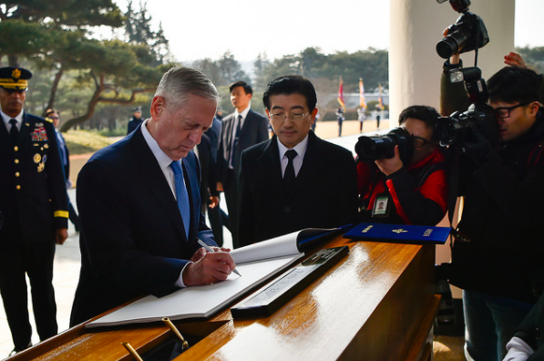 The U.S. SECDEF signs the guestbook during the wreath laying ceremony with the Republic of Korea's Minister of National Defense, the Honorable Han Min-goo.