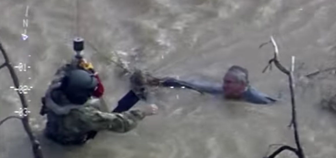 (Watch) CA National Guard Black Hawk Crew Rescues Man From Rushing Water During Flood Featured