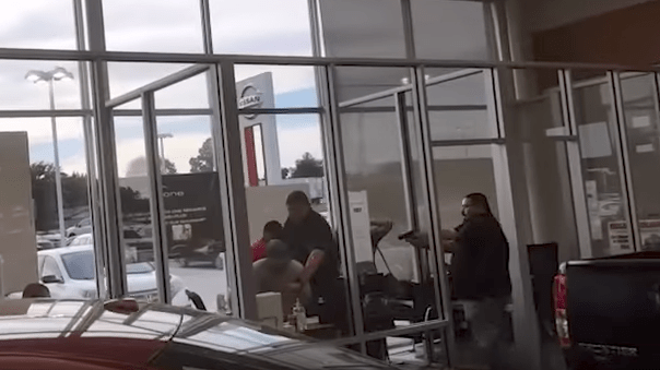 (Raw Video) Bounty Hunters, Fugitive Killed In Gunfight At Car Dealership Featured