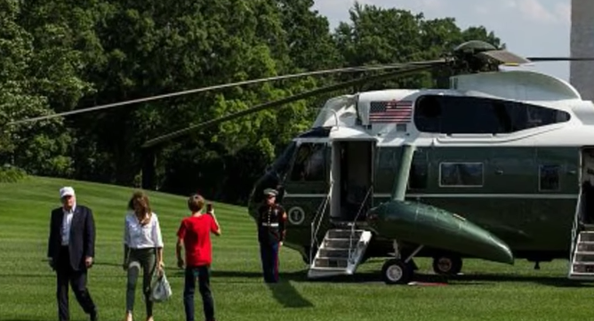 Barron Trump & the Marine: Barron, impressed, snaps pictures of a Marine after exiting Marine One Featured