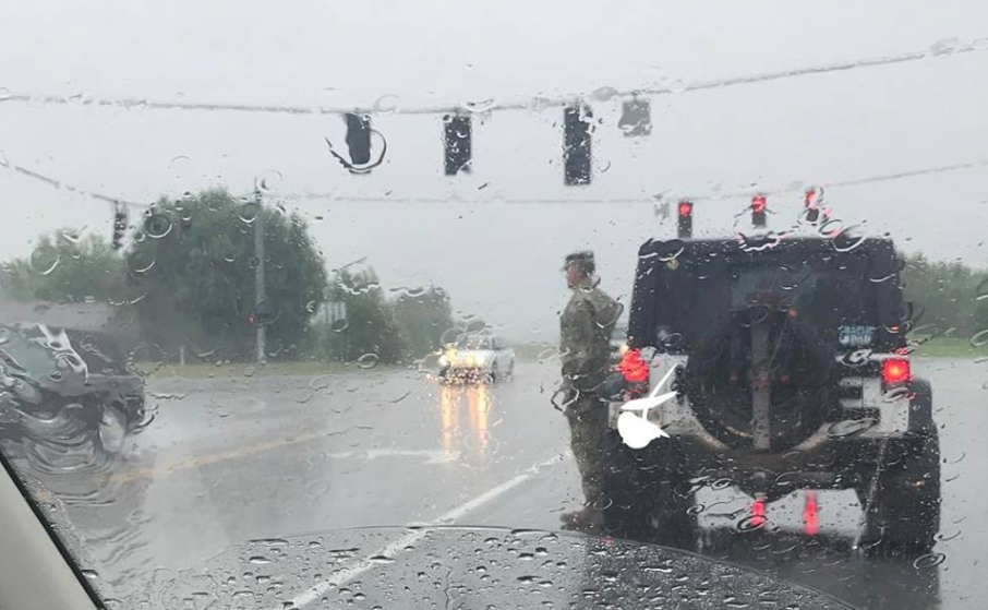 Screen Shot 2017 07 18 at 3.21.12 PM - (PHOTO) Army soldier gets out of car in the pouring rain to salute funeral procession