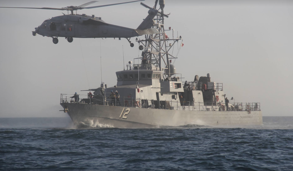 US Navy ship fires warning shots at Iranian boat Featured
