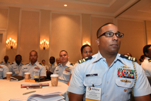 Audience members listen as Coast Guard Adm. Charles Ray, Coast Guard Vice Commandant, speaks at the National Naval Officer's Association annual conference.