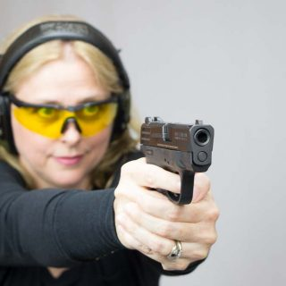 Smith_&_Wesson_M&P_Shield_-_Woman_Shooting
