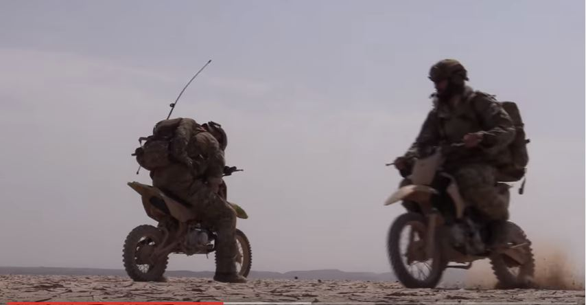 US Air Force Special Operations Forces airmen use dirt bikes to prepare landing strip in the desert Featured