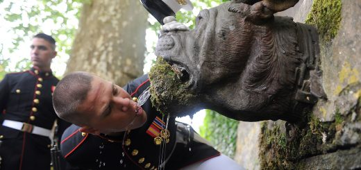 Lance Cpl. Seth H. Capps, a member of the United States Marine Corps Silent Drill Platoon, drinks out of Devil Dog Fountain following the 93rd anniversary of the Battle for Belleau Wood May 30. (Photo By Cpl. Bobby J. Yarbrough)