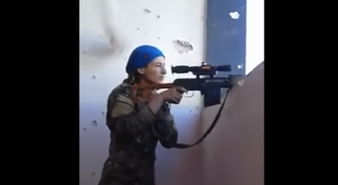(VIDEO) Kurdish YPJ sniper laughs after sniper fire misses her head by inches Featured