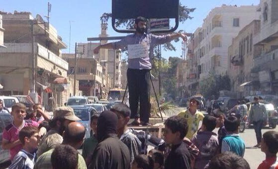 aleppo false testimony - ISIS Crucifies Its Own Corrupt Checkpoint Guard